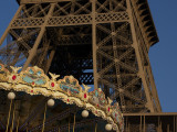 The juxtaposition of the strength of the Eiffel Tower and the whimsical feel of the carousel
